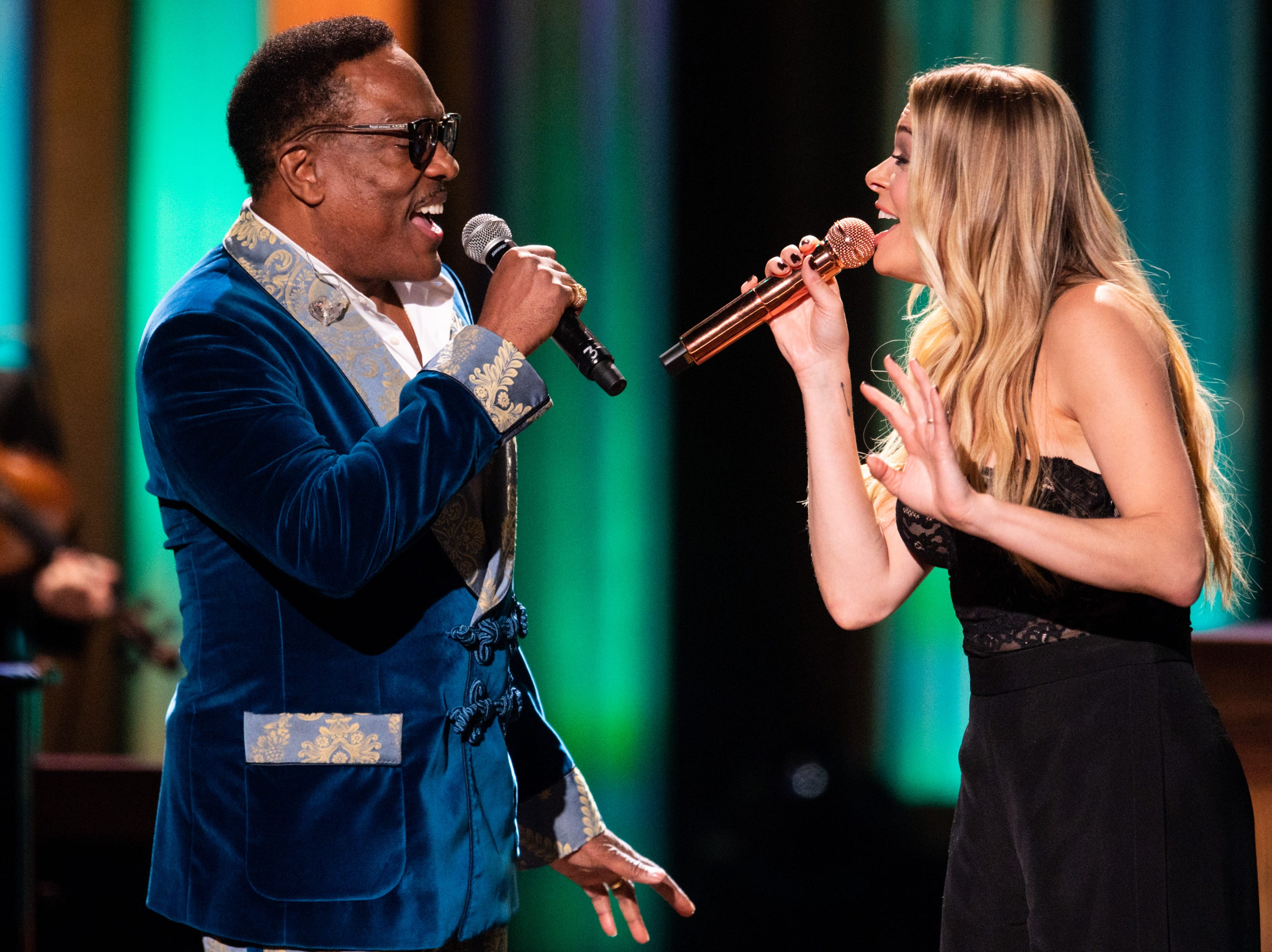 Charlie Wilson and LeAnn Rimes perform during the An Opry Salute to Ray Charles concert at The Grand Ole Opry in Nashville, Tenn., Monday, Oct. 8, 2018.