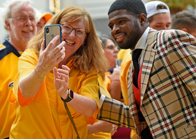 Nashville Predators defenseman P.K. Subban (76) poses for a photo with a fan on the Gold Walk before the home opener at Bridgestone Arena in Nashville, Tenn., Tuesday, Oct. 9, 2018.