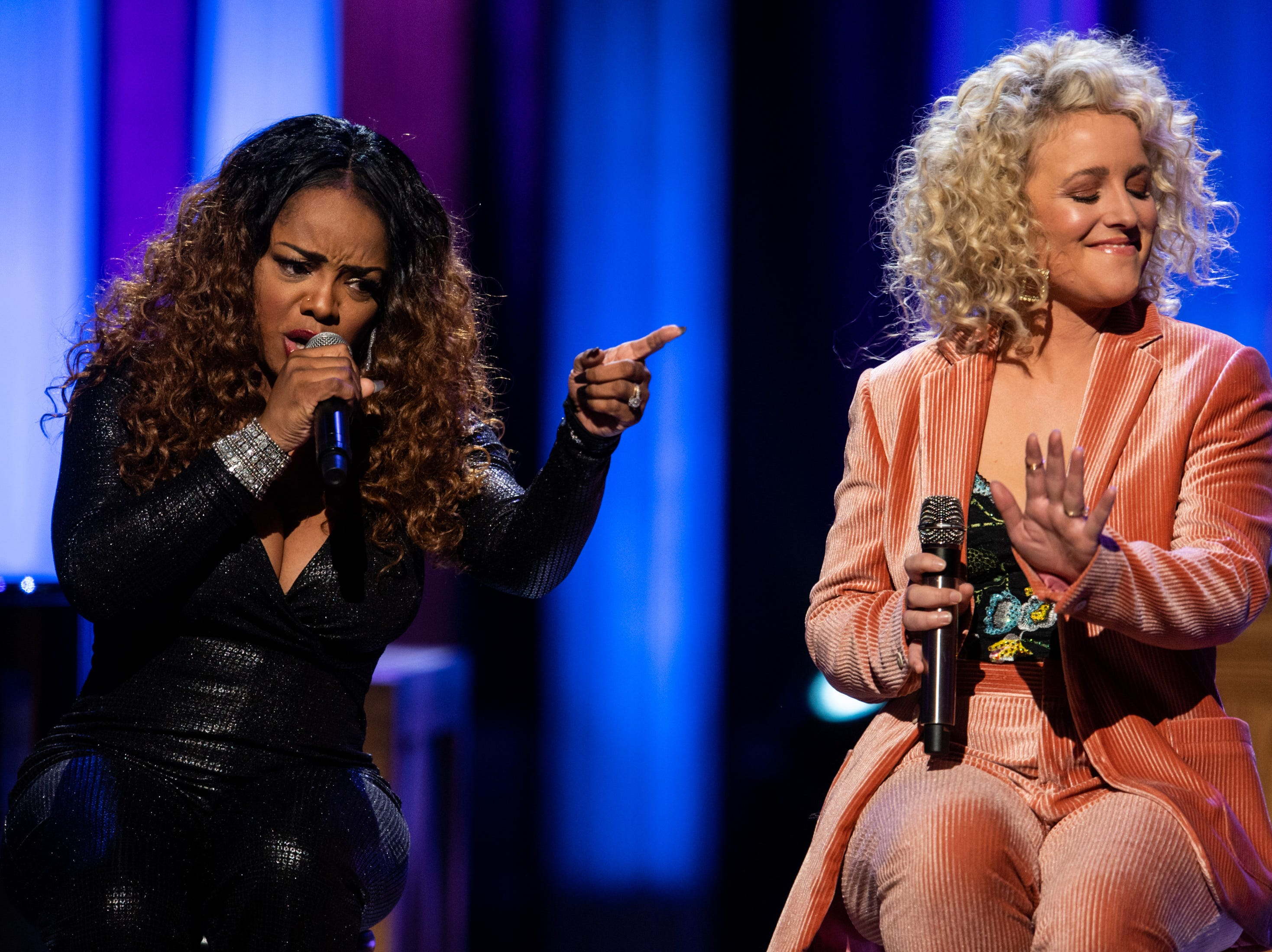 Leela James, left, and Cam, right, perform during the An Opry Salute to Ray Charles concert at The Grand Ole Opry in Nashville, Tenn., Monday, Oct. 8, 2018.
