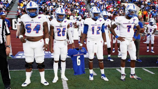 Tennessee State's captains carried middle linebacker Christion Abercrombie's No. 6 jersey with them for the pregame coin toss at Austin Peay. Abercrombie suffered a severe head injury against Vanderbilt the week before and is listed in critical condition at Vanderbilt University Medical Center.