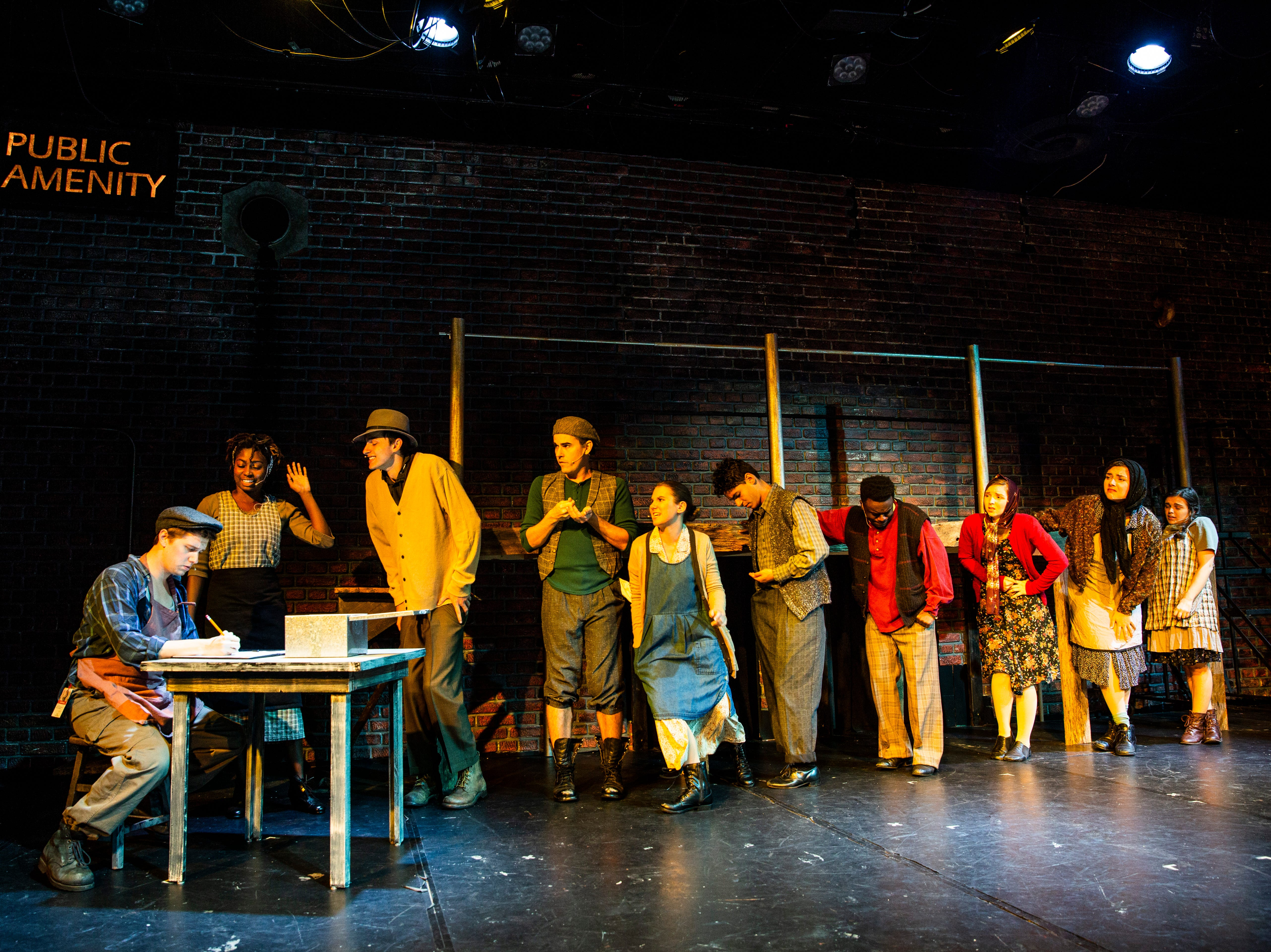 Cast members rehearse a scene for TheatreZone's upcoming production of Urinetown in collaboration with Florida Gulf Coast University in Fort Myers on Monday, Oct. 8, 2018. Urinetown is a hilarious musical satire of the legal system, capitalism, social irresponsibility, populism, bureaucracy, corporate mismanagement, municipal politics and musical theatre itself.
