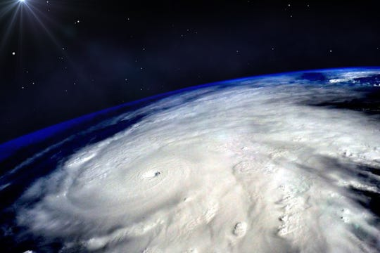 Hurricane typhoon over Earth viewed from space. Elements of image are furnished by NASA.