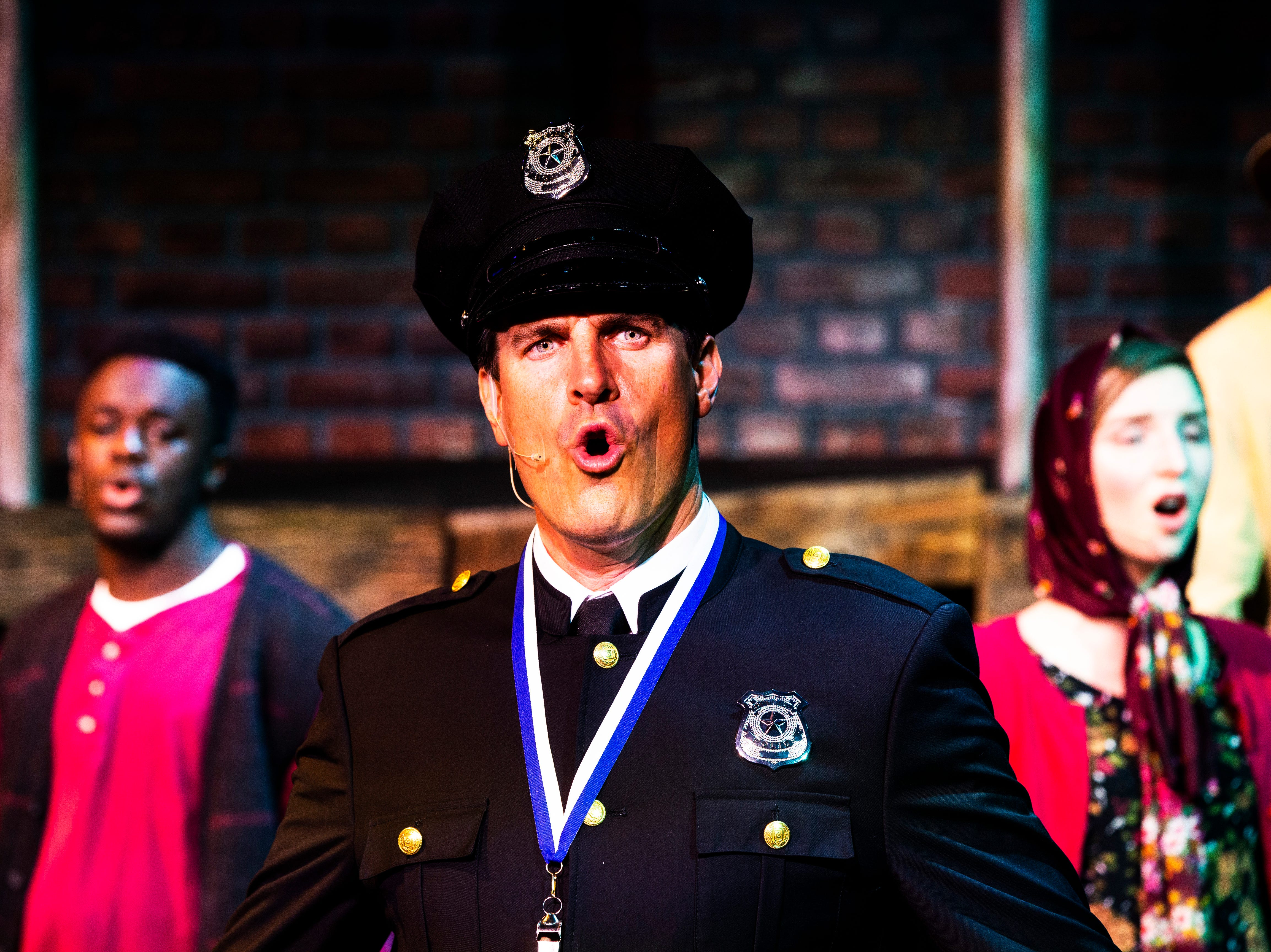 Gerritt VanderMerr, as Officer Lockstock, rehearses for TheatreZone's upcoming production of Urinetown in collaboration with Florida Gulf Coast University in Fort Myers on Monday, Oct. 8, 2018. Urinetown is a hilarious musical satire of the legal system, capitalism, social irresponsibility, populism, bureaucracy, corporate mismanagement, municipal politics and musical theatre itself.