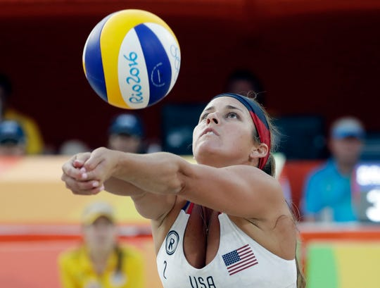 In this Aug. 9, 2016, file photo, United States' Brooke Sweat sets up against Brazil during a women's beach volleyball match at the 2016 Summer Olympics in Rio de Janeiro, Brazil. Three-time beach Olympic volleyball gold medalist Kerri Walsh Jennings has a new partner as she tries to qualify for the 2020 Summer Games in Tokyo. Walsh Jennings tells The Associated Press she will pair with Rio Olympian Brooke Sweat, a defensive specialist.