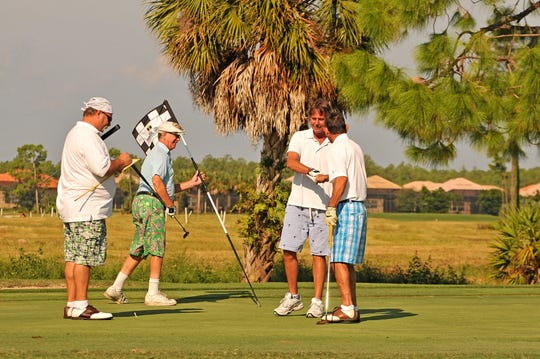 Golfers celebrate a great putt during the 2009 Fancy Pants golf tournament. This year's tournament, which is Saturday at The Naples Beach Hotel & Golf Club, has been renamed the Jerry Conti Memorial Fancy Pants Golf Tournament in honor of Conti, who helped found the Cancer Alliance of Naples and the tournament. Conti died in 2016.
