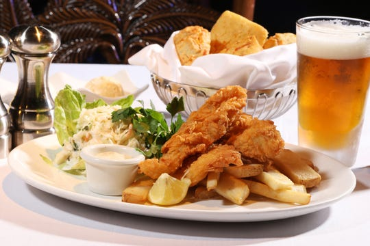 Yabba Island Grill in downtown Naples has 20 percent off all steaks and lobster and half off all other entrees on its dinner menu through Friday, Oct. 12, such as this Crispy-Crunchy seafood entrée with battered fish and four Gulf shrimp with tartar sauce and French fries.