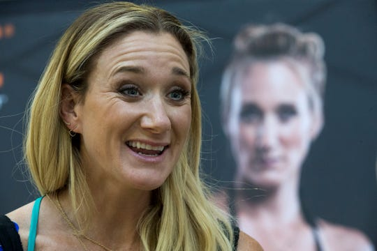 In this March 22, 2016, file photo, Kerri Walsh Jennings speaks to reporters during a news conference in New York. Three-time beach Olympic volleyball gold medalist Kerri Walsh Jennings has a new partner as she tries to qualify for the 2020 Summer Games in Tokyo. Walsh Jennings tells The Associated Press she will pair with Rio Olympian Brooke Sweat, a defensive specialist.