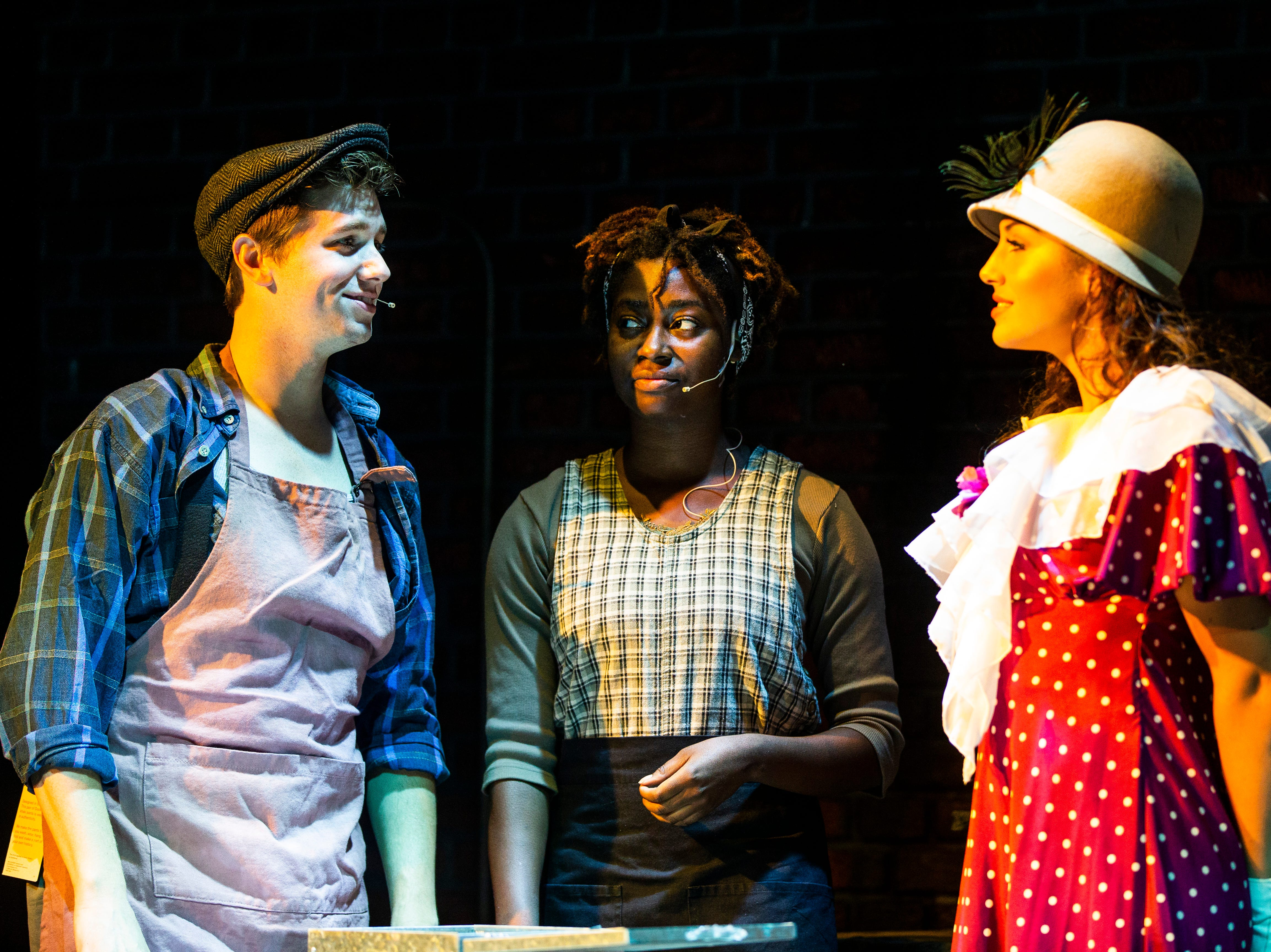 Christopher Lewis, from left, as Bobby Strong, Imani Williams, as Penelope Pennywise, and Julia Hajjar, as Hope Cladwell, rehearse a scene for TheatreZone's upcoming production of Urinetown in collaboration with Florida Gulf Coast University in Fort Myers on Monday, Oct. 8, 2018. Urinetown is a hilarious musical satire of the legal system, capitalism, social irresponsibility, populism, bureaucracy, corporate mismanagement, municipal politics and musical theatre itself.