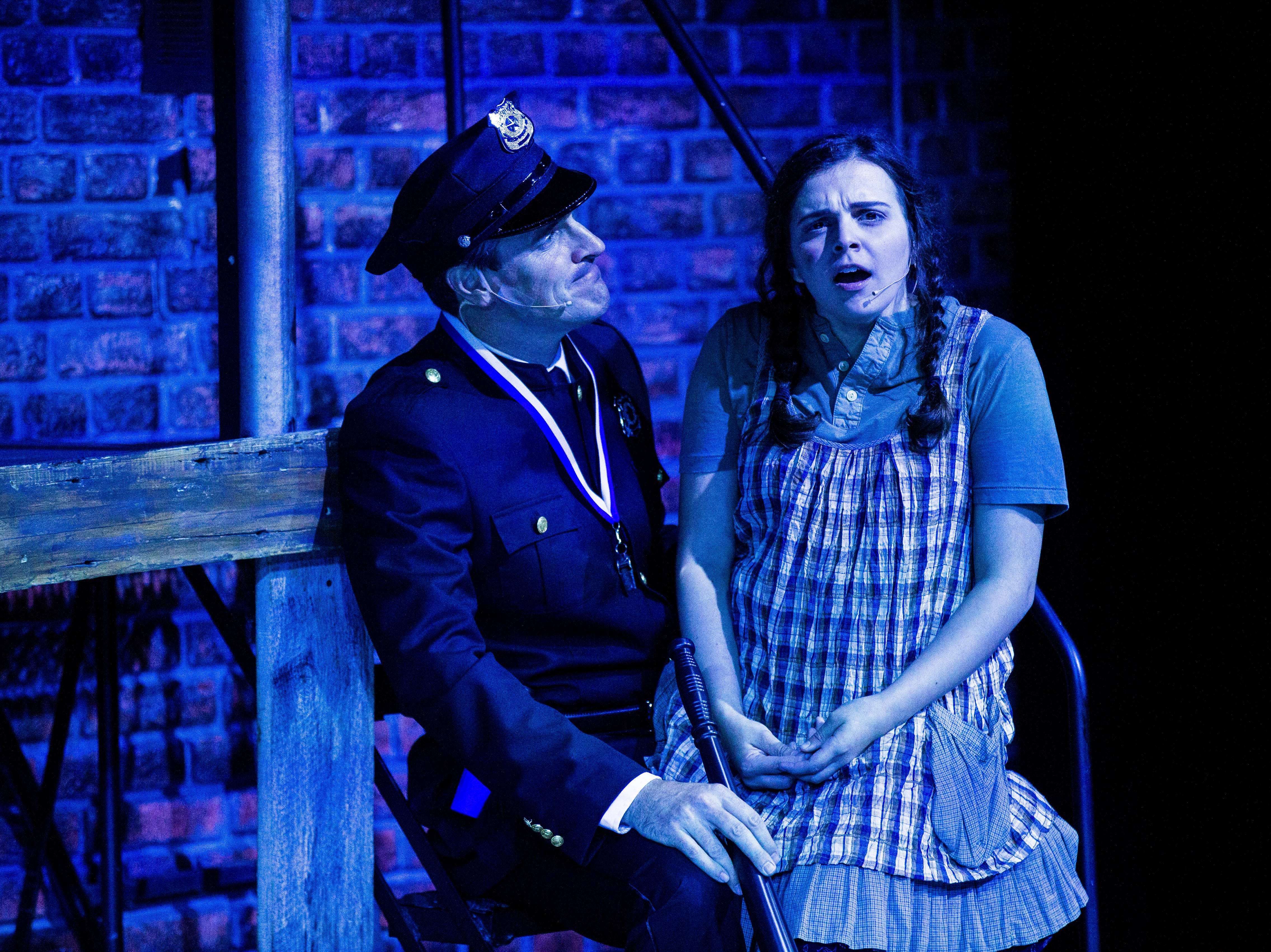 Gerritt VanderMerr, left, as Officer Lockstock, and Rachel Salerno, as Little Sally, rehearse a scene together for TheatreZone's upcoming production of Urinetown in collaboration with Florida Gulf Coast University in Fort Myers on Monday, Oct. 8, 2018. Urinetown is a hilarious musical satire of the legal system, capitalism, social irresponsibility, populism, bureaucracy, corporate mismanagement, municipal politics and musical theatre itself.