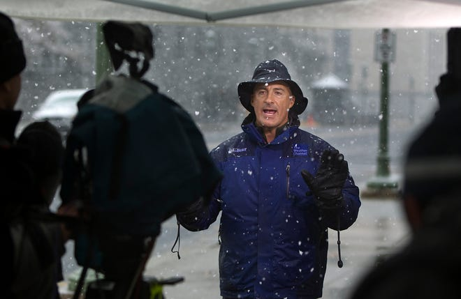 In this Oct. 29, 2011, file photo, The Weather Channel host Jim Cantore goes live from Commonwealth Avenue behind the Pennsylvania State Capitol in Harrisburg, Pa.