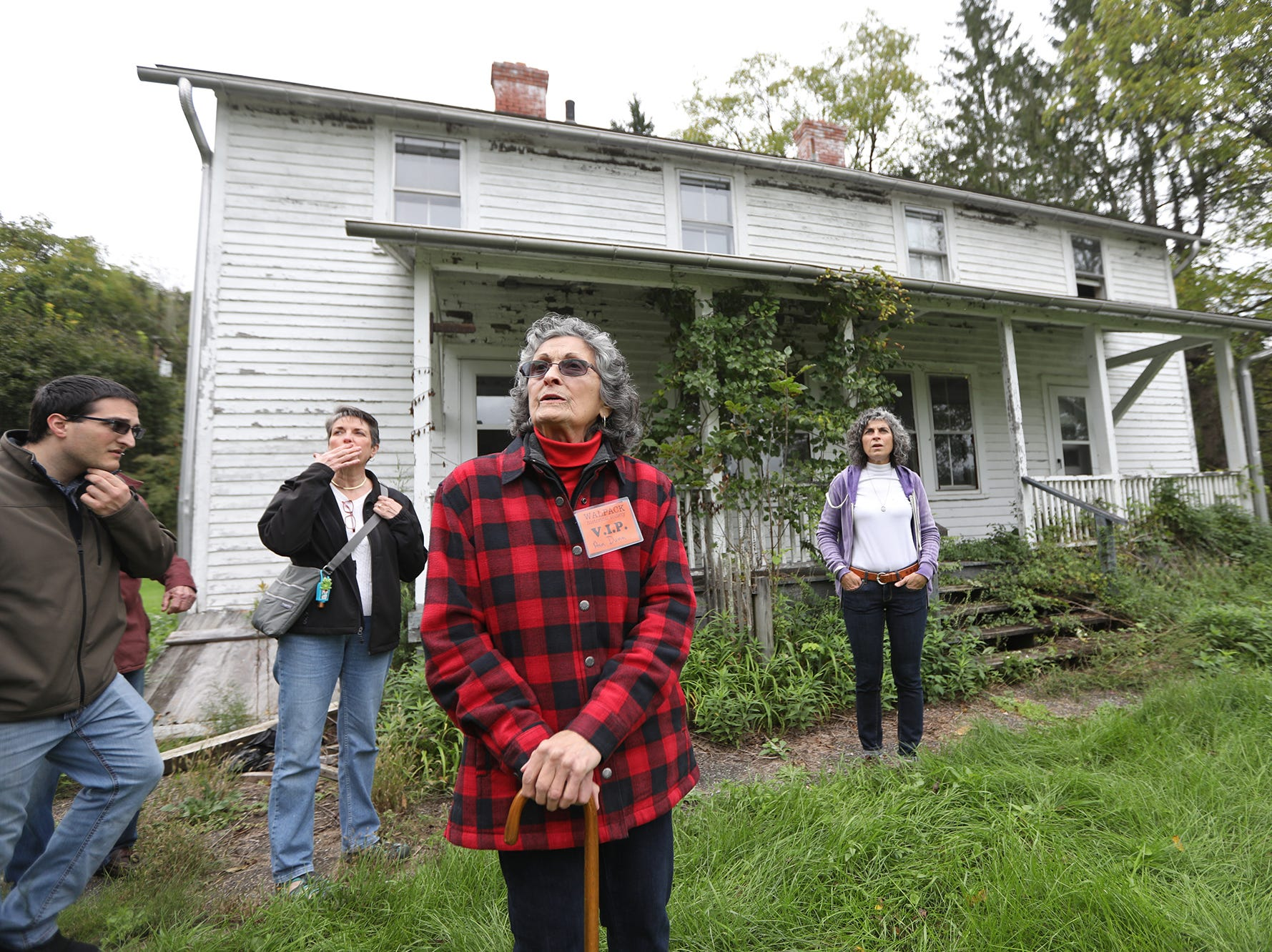 Ann Dunn is shown with family in front of the home where she grew up. The family is looking toward a detached garage her father built. Sunday, September 23, 2018