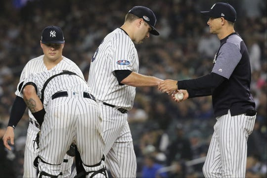 Lance Lynn hands the ball over to Manager, Aaron Boone, after pitching less than an inning. Monday, October 8, 2018