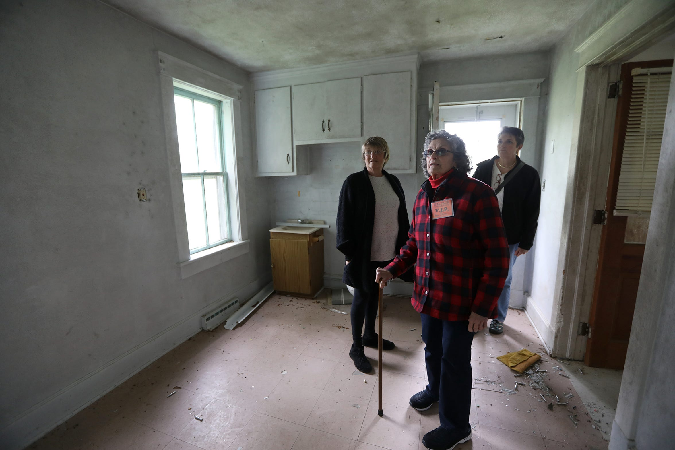 Ann Dunn is shown with family in the home where she grew up. The Walpack home has been abandoned for years and has fallen into disarray. Sunday, September 23, 2018