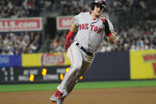 Andrew Benintendi, of the Red Sox, heads to third as Boston scored 10 runs before the fifth inning. Monday, October 8, 2018