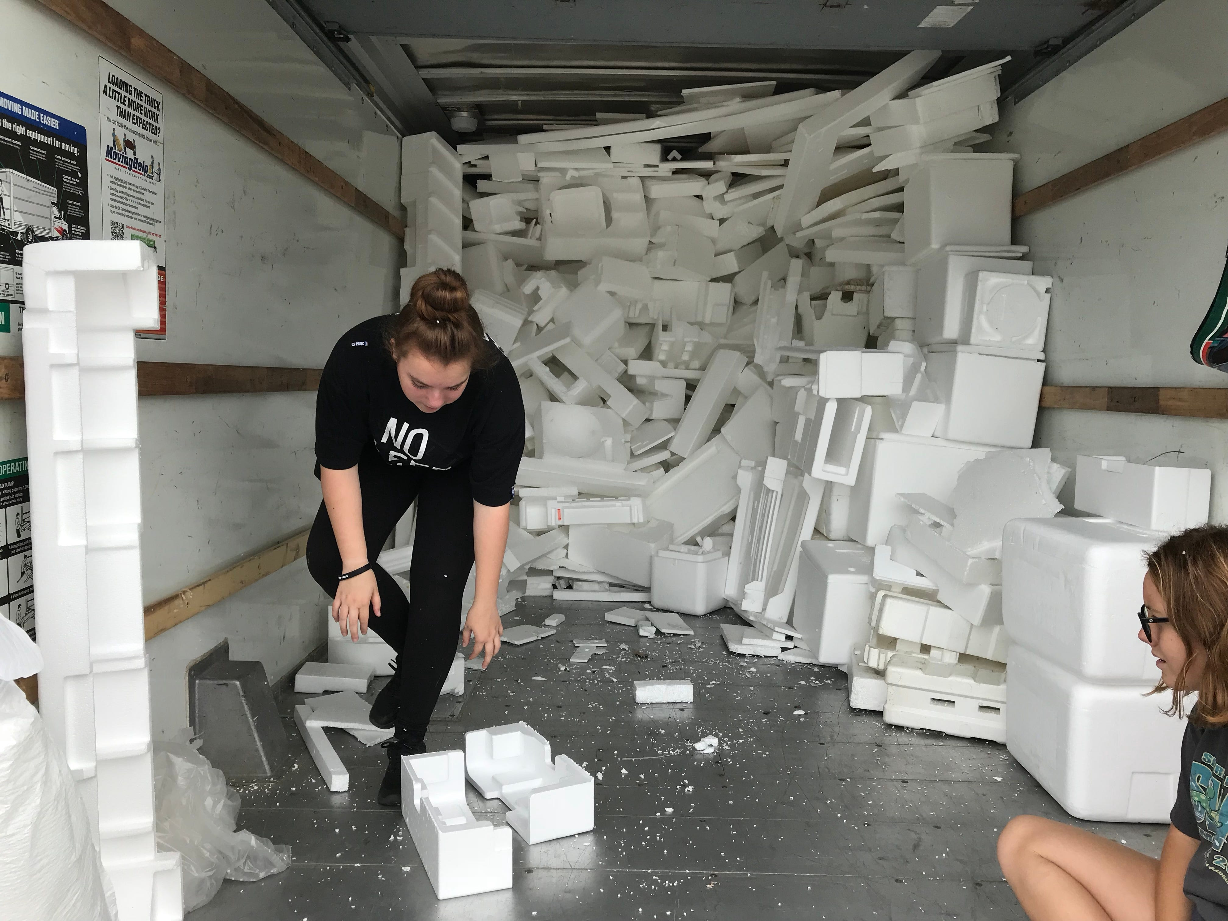 Volunteers help fill box truck with Styrofoam at Glen Rock Recycling Center.