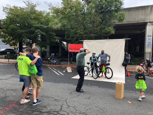 """Cyclists pose for the """"Pedal Portrait Project"""" at the Tour de Montclair, sponsored by Phil Cantor Photography . October 7, 2018"""