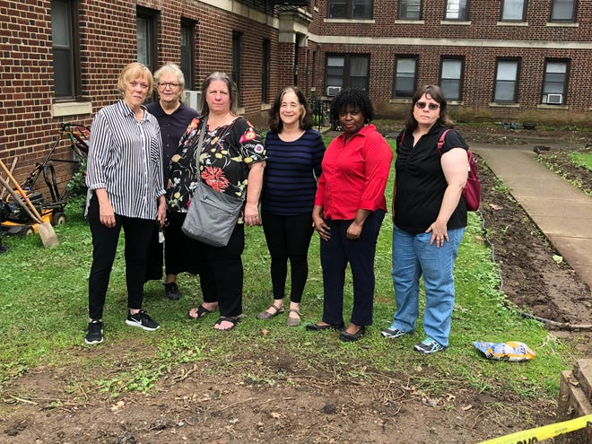 A tenants group formed to protest rent increases gathers outside 39-41 North Fullerton Avenue. From left to right: Antoinette Martin, Danice Bordett, Dawn Sterling, Evelyn Leonard, Ingrid Smith and Jan Schwartz.