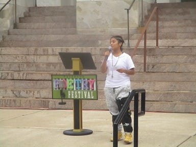 Anna Hernandez recites her poem at Paterson's Poetry Festival on Saturday