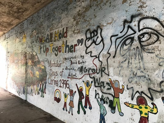 "Murals under Montclair's Chestnut Street bridge include this 1996 ""Montclair Days of Caring"" artwork."