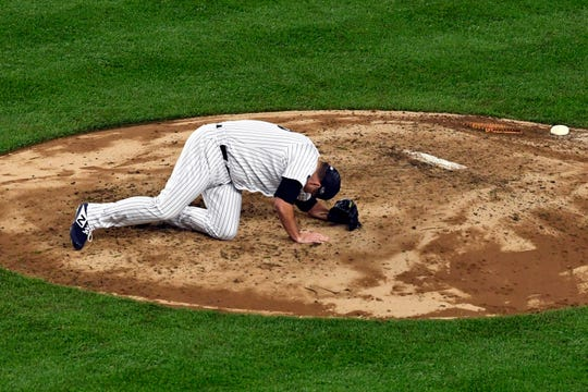New York Yankees pitcher Lance Lynn slips on the mound in Game 3 of the American League Division Series on Monday, Oct. 8, 2018, in New York.