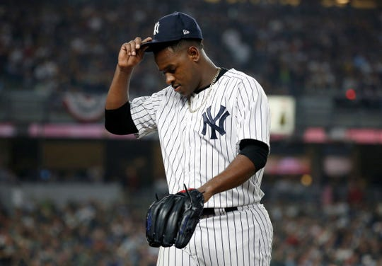 Oct 8, 2018; Bronx, NY, USA; New York Yankees starting pitcher Luis Severino (40) reacts after being relieved in the fourth inning against the Boston Red Sox in game three of the 2018 ALDS playoff baseball series at Yankee Stadium.