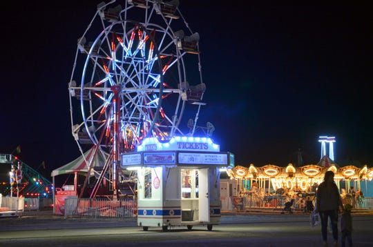 The carnival ride and games are a main attraction at fair time in Luna County.