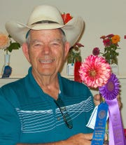 "For the second year in a row Cal Gray took home ""Best of Show"" in the Flower Show."