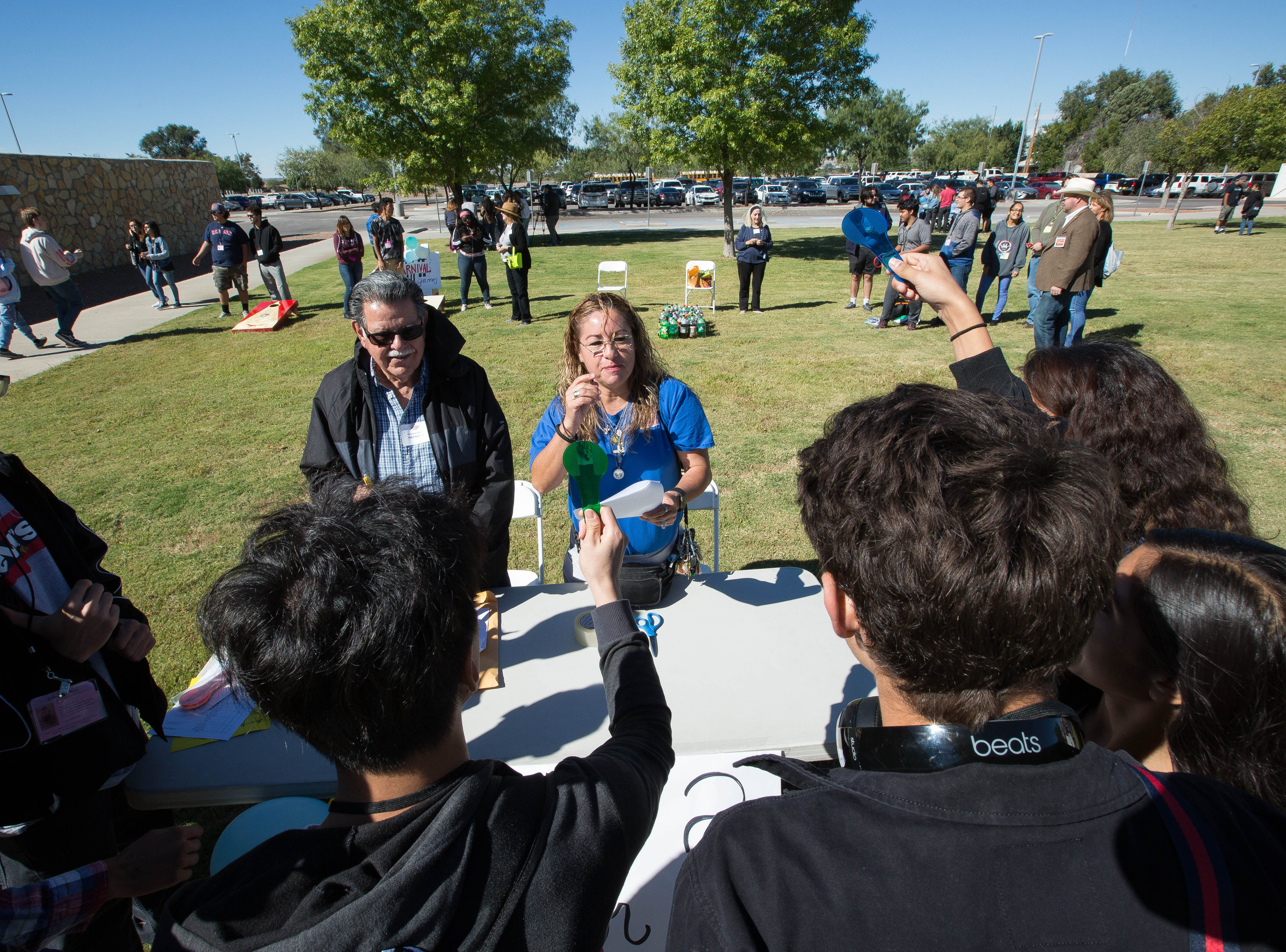 Gina Ortega, right, and Fidel Sanchez, left, quiz a group of Las Cruces High School students during a game of Fact or Fiction, during the Celebrating Democracy in Doña Ana County event, Tuesday, Oct. 9, 2018, at the Doña Ana County Government Center. Abount 300 seniors from area high schools came to the event.