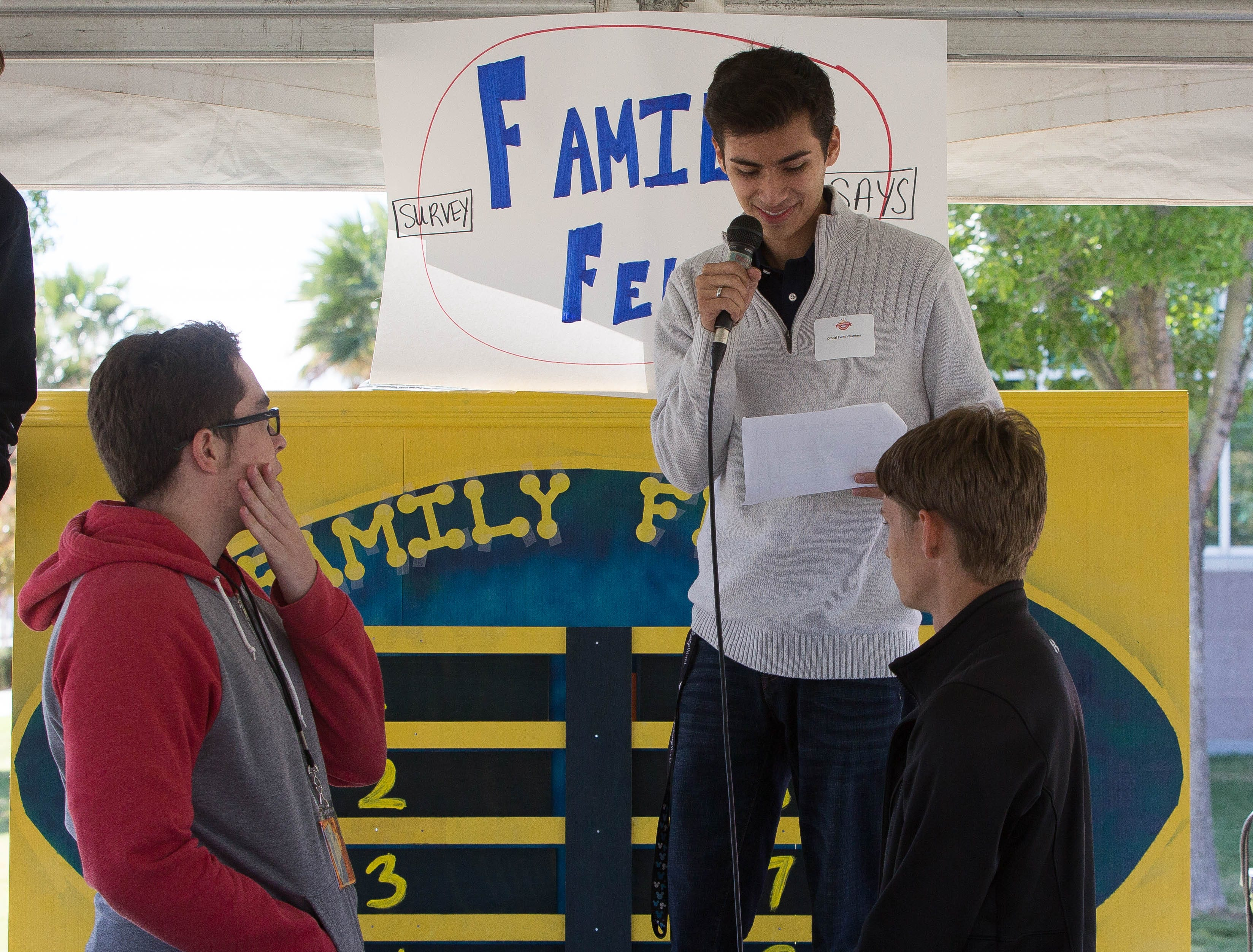 "Mathew Madrid, the Associated Students of New Mexico State University Assistant Director of Governmental Affairs, asks a question about the county's original colonies to ""Family Feud"" contestants Caleb Estep, 18, left, from Centennial High School, and Jay Choate, 17, from Oñate High School on Tuesday Oct. 9, 2018. About 300 seniors from area high schools came to a Celebrating Democracy event at the Doña Ana County Government Center."