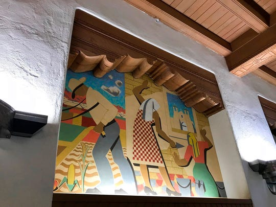A Great Depression-era mural that depicts Hispanics is seen on the wall of the west wing at the University of New Mexico's Zimmerman Library in Albuquerque, N.M., on Monday, Oct. 8, 2018. The mural is among a series of paintings that would be covered amid complaints.