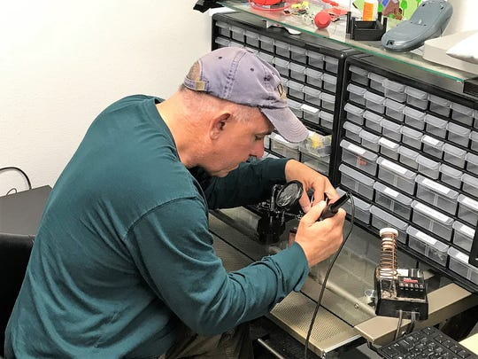 Richard Guadalupe McDonald, a biomedical researcher and former Army captain, works on his prototype at a soldering station at Arrowhead Center. McDonald worked with the Foster Innovation Exchange at New Mexico State University's Arrowhead Center to create a prototype that will help him move his product closer to reality.