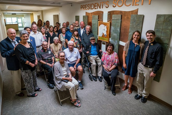 Some of the inaugural Western New Mexico University Foundation's President's Society members gather at the wall where they are recognized for gifting at least $1,000 in unrestricted funds annually.