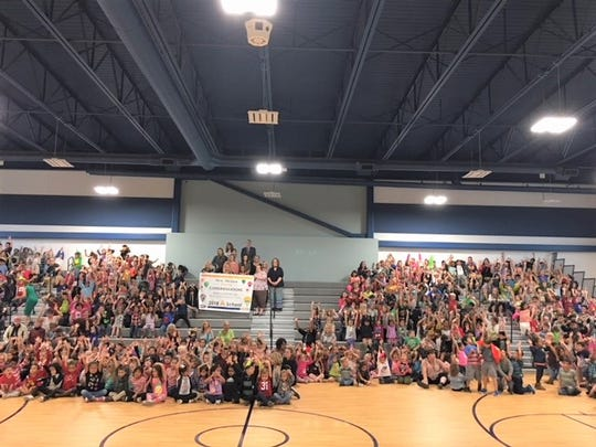 Sierra Vista Primary 'Wee Warriors' cheer on their teachers and principal, Romero, after receiving the letter grade 'A' from NMPED.