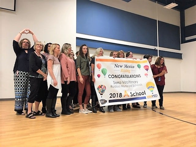 Proud teachers and principal, Angela Romero at Sierra Vista Primary after receiving the letter grade 'A' from the New Mexico Public Education Department.