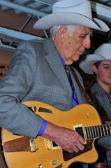 In this file photo, the late guitarist Tommy Allsup plays on stage during the 2011 Lincoln County Cowboy Symposium.
