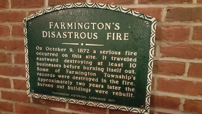 This plaque is located just inside Cowley's in Farmington, the site where the 1872 Farmington fire originated.