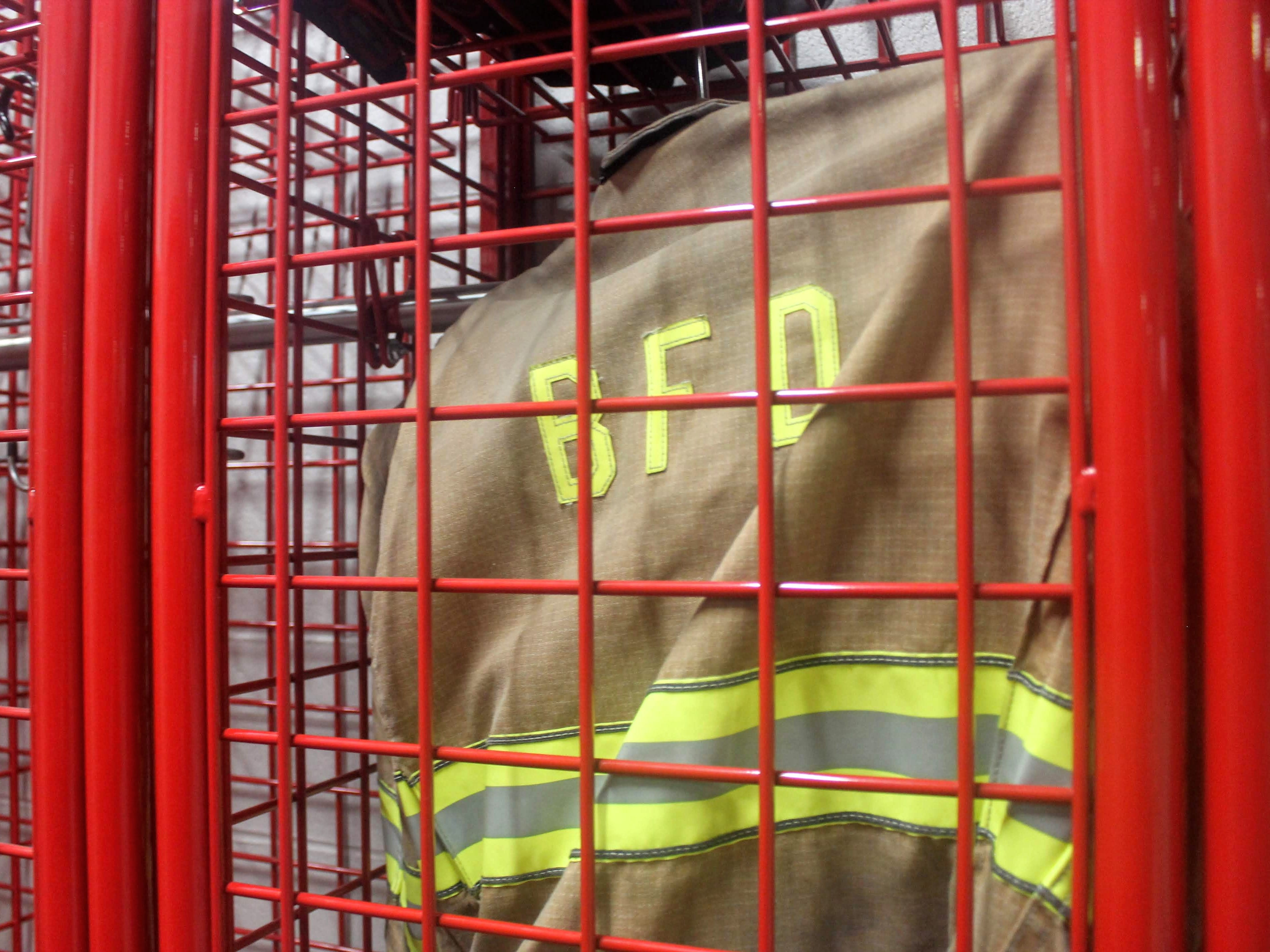Fire fighting equipment hangs in a locker near the apparatus bay in the new Chesterfield Fire Station.