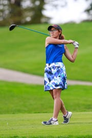 Xavier's Clair Phakamad hits a tee shot during the second round of the WIAA Division 2 State Girls Golf Tournament on Tuesday at University Ridge in Madison.
