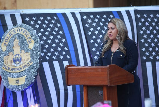 """Gloria Vega speaks during a vigil for her father Jose """"Gil"""" Vega and Lesley Zerebny at the Palm Springs Police Department commemorating the two-year anniversary of their passing, October 8, 2018."""