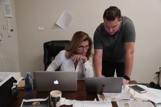 Kimberlin Brown Pelzer works with her campaign manager Brandon Jones in her Cathedral City office, August 22, 2018.
