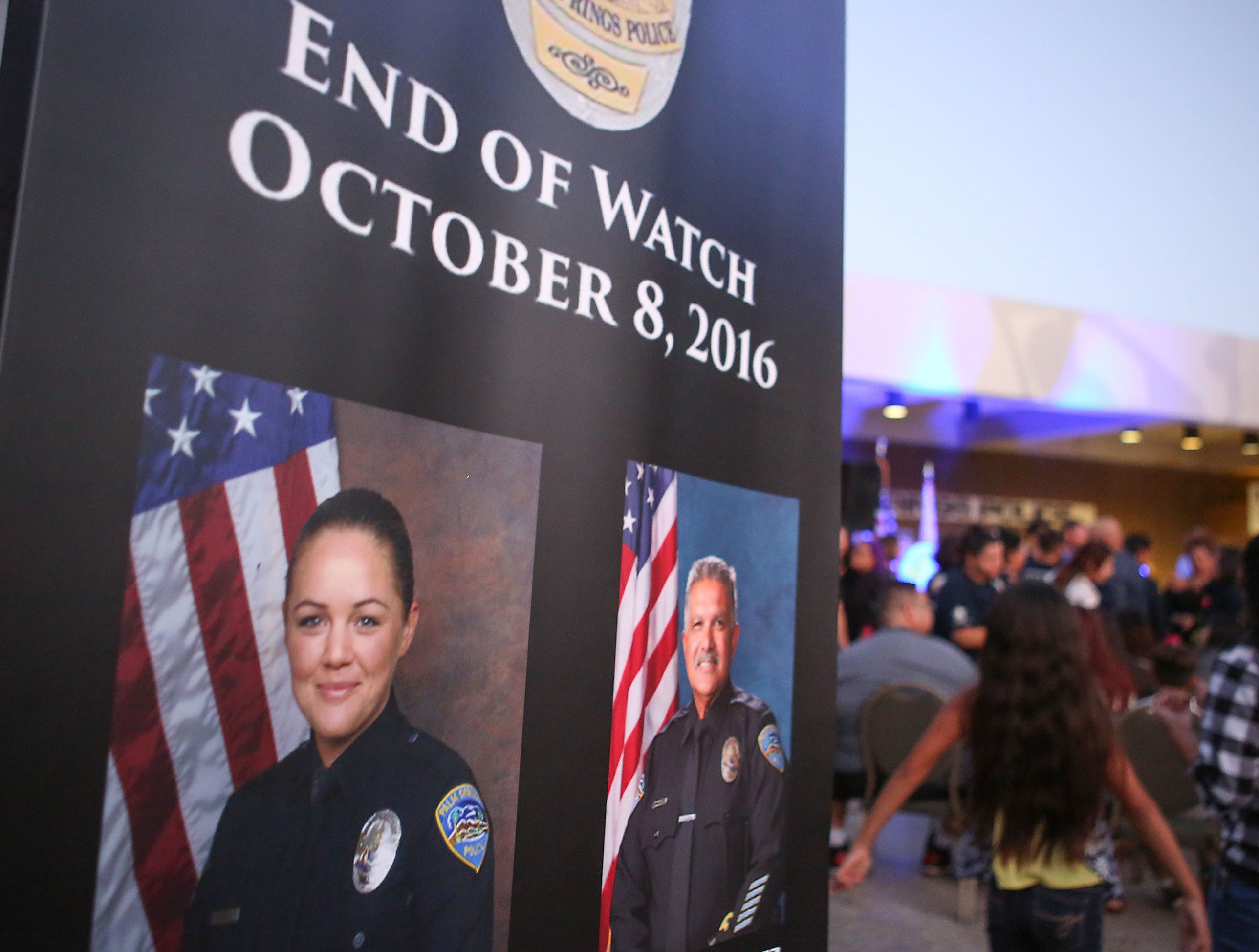 "A large crowd attends the vigil for Jose ""Gil"" Vega and Lesley Zerebny at the Palm Springs Police Department commemorating the two-year anniversary of their passing, October 8, 2018."