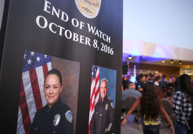 """A large crowd attends the vigil for Jose """"Gil"""" Vega and Lesley Zerebny at the Palm Springs Police Department commemorating the two-year anniversary of their passing, October 8, 2018."""