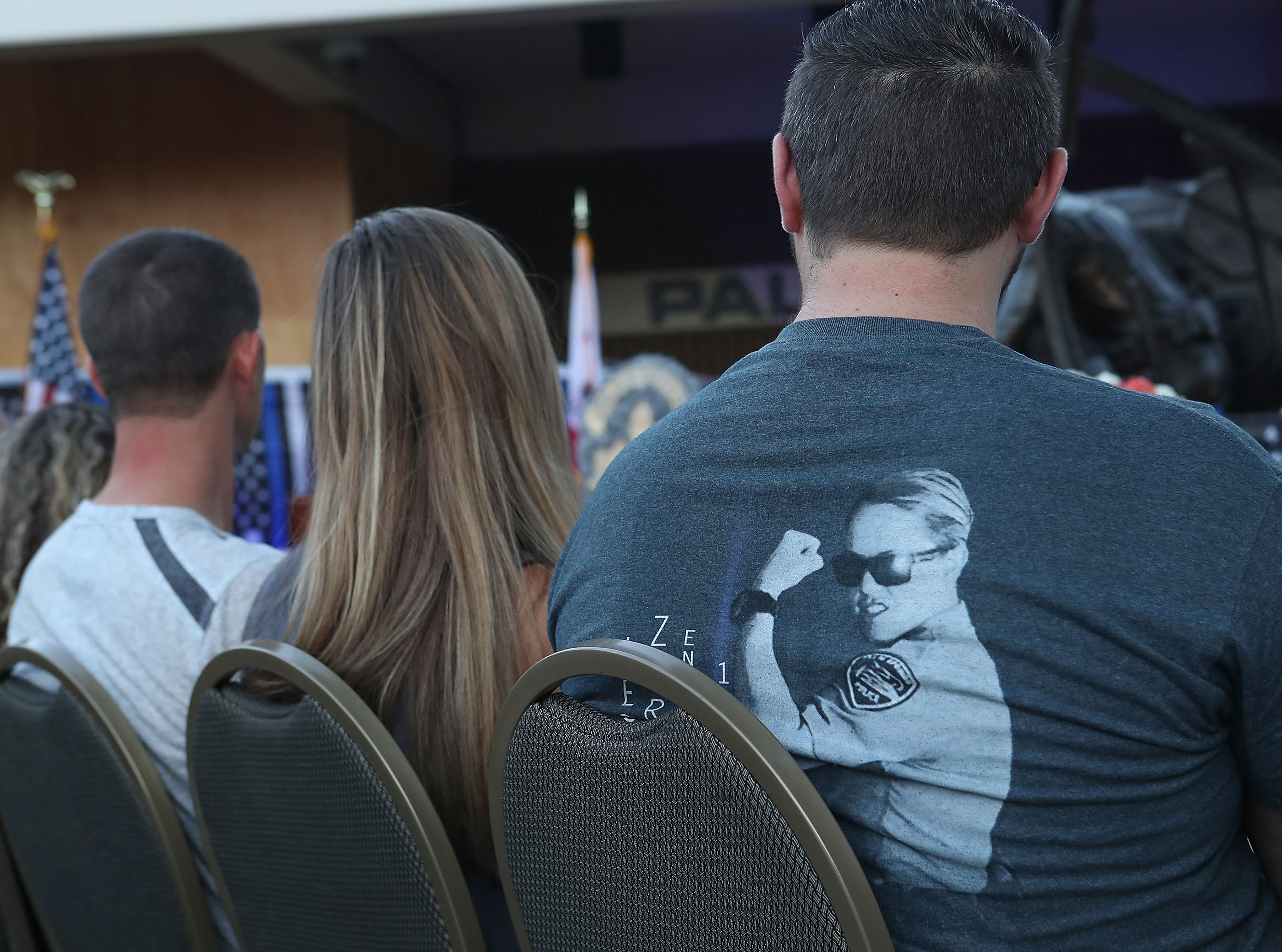 A t-shirt with an image of Lesley Zerebny is worn by a family member during a vigil at the Palm Springs Police Department commemorating the two-year anniversary of her passing, October 8, 2018.