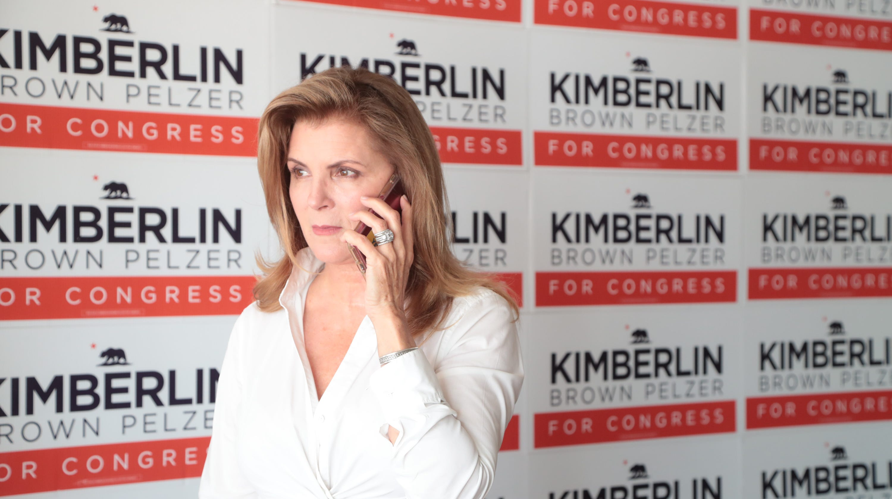 Kimberlin Brown Pelzer makes a call in her Cathedral City campaign office, August 22, 2018.