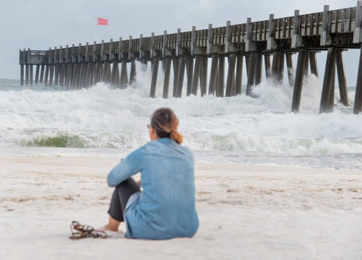Tiffany Chen Of Pensacola Watches The Higher Than Normal Waves At Beach In