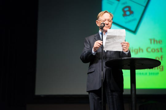 Quint Studer introduces CivicCon speaker Donald Shoup before he speaks about ways to get parking right on Tuesday, Oct. 9, 2018, at the Rex Theatre.
