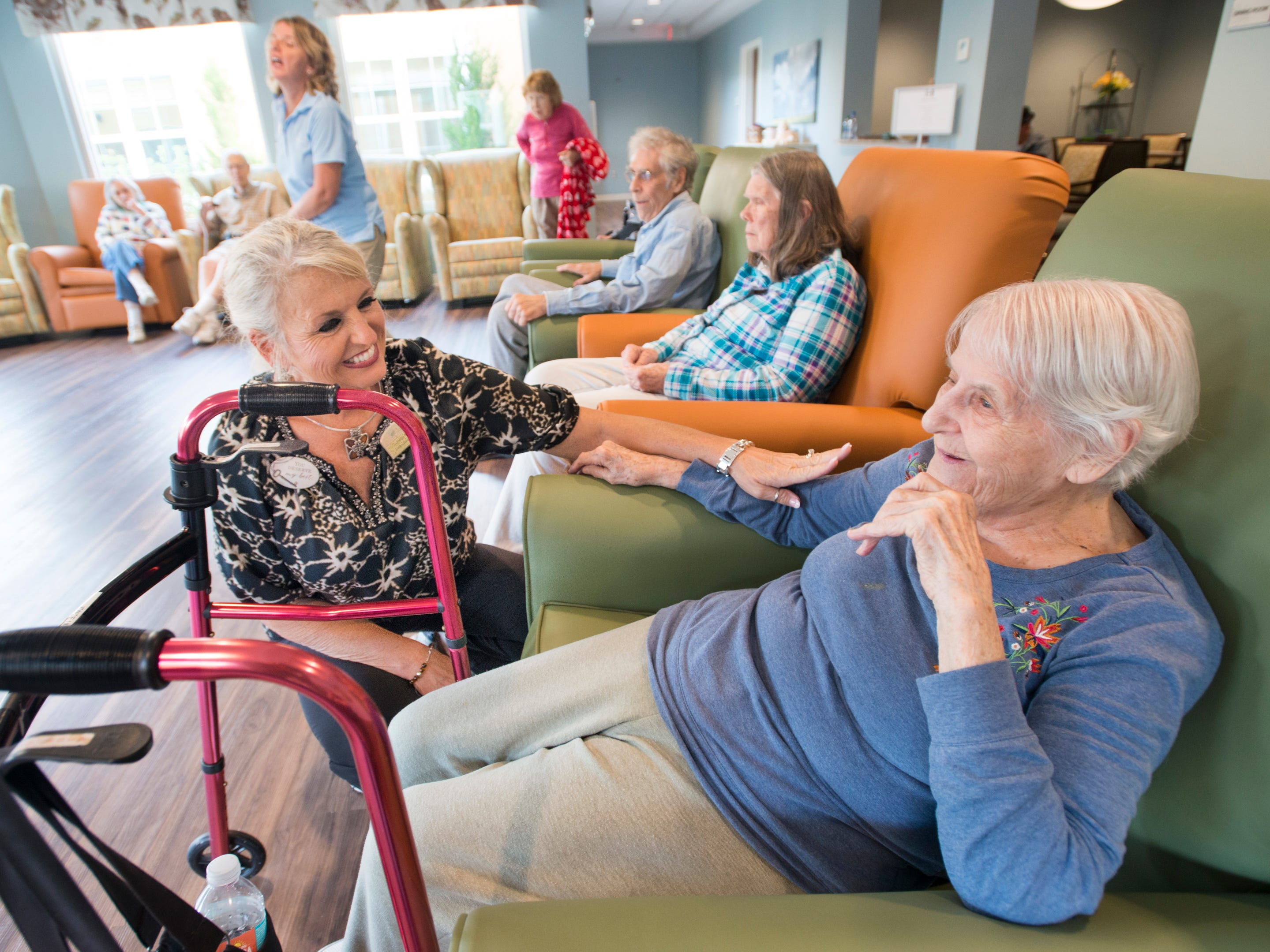 Executive director Lonette Bentley, left, chats with Joyce Ullmann, a resident of the Seagrass Village of Panama City Beach, on Tuesday, Oct. 9, 2018, at The Arbors of Gulf Breeze senior living community. Residents and staff from Panama City were evacuated to the Gulf Breeze sister community as Hurricane Michael approaches the Panhandle.