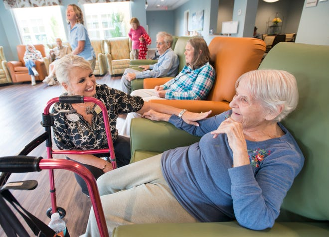 Executive director Lonette Bentley, left, chats with Joyce Ullmann, a resident of the Seagrass Village of Panama City Beach, on Tuesday at The Arbors of Gulf Breeze senior living community. Residents and staff from two Panama City facilities were evacuated to Gulf Breeze as Hurricane Michael approached the Panhandle.