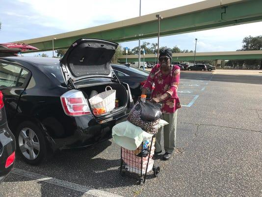 Stella Matthews heads to hurricane shelter