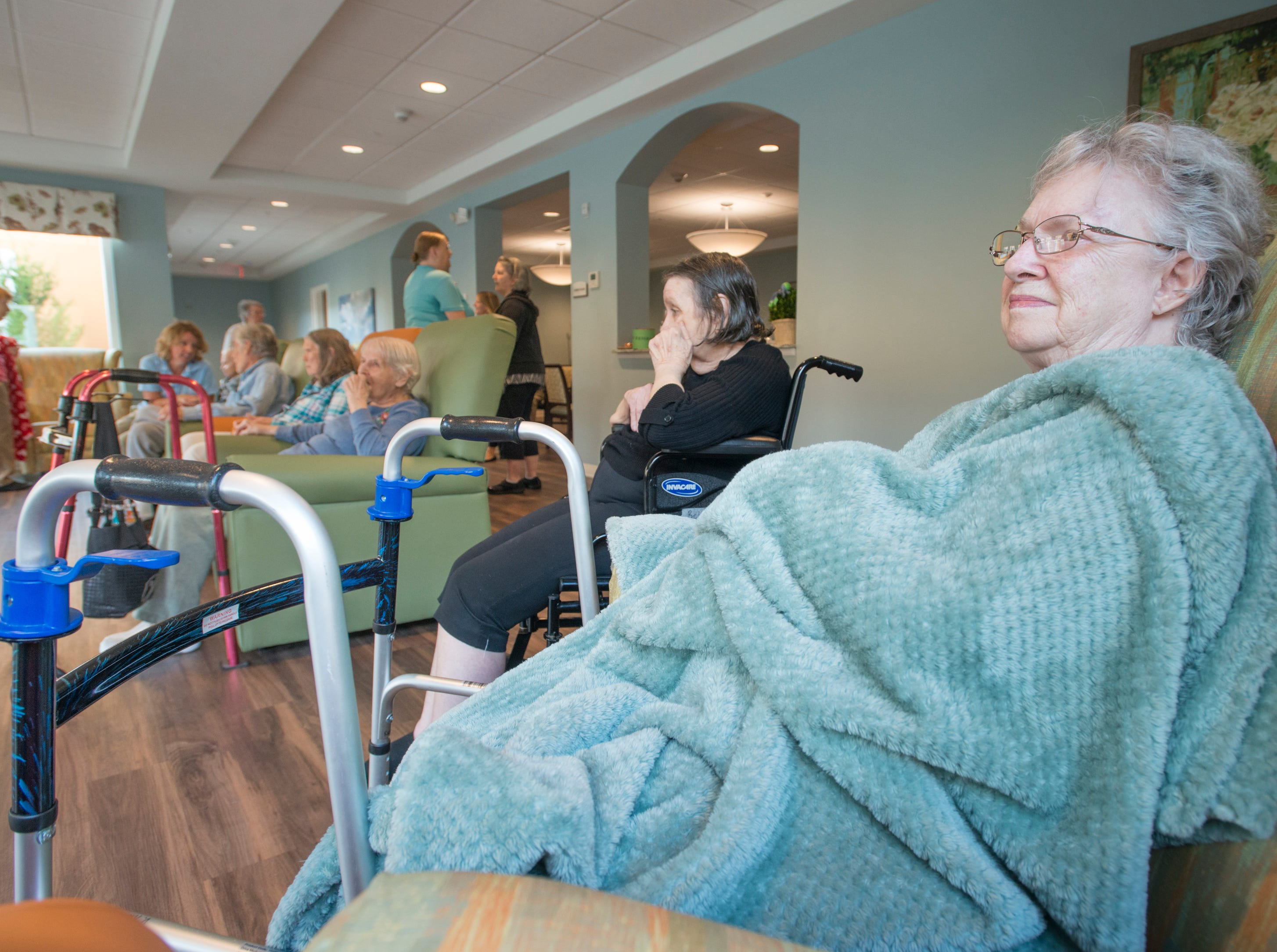 Violet Keen and fellow residents of the Seagrass Village of Panama City Beach take temporary shelter Tuesday, Oct. 9, 2018, at The Arbors of Gulf Breeze senior living community.
